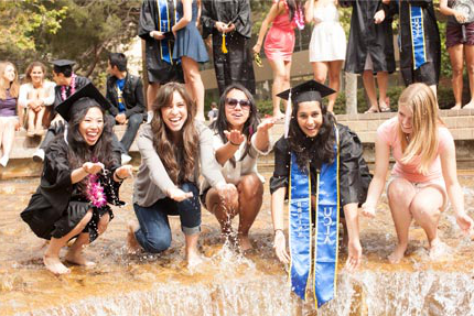 Graduating students playing in the inverted fountain