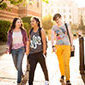 Three female students walking to class