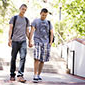 Two male students holding hands